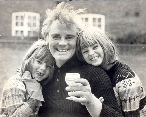 That was then...: Lauren, pictured here on the right with her father and sister Emma, claims her childhood was characterised by violence and neglect