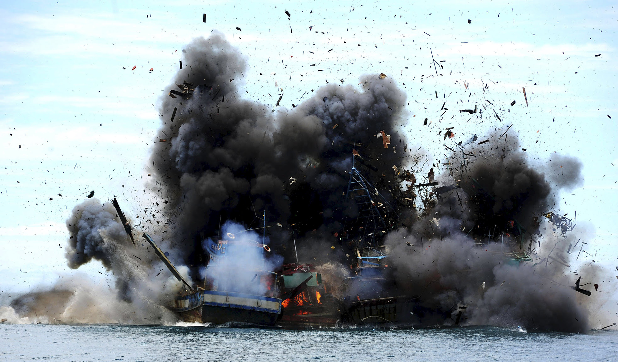 Four of eight confiscated Vietnamese fishing boats are destroyed in Mempawah Regency, West Kalimantan, Indonesia