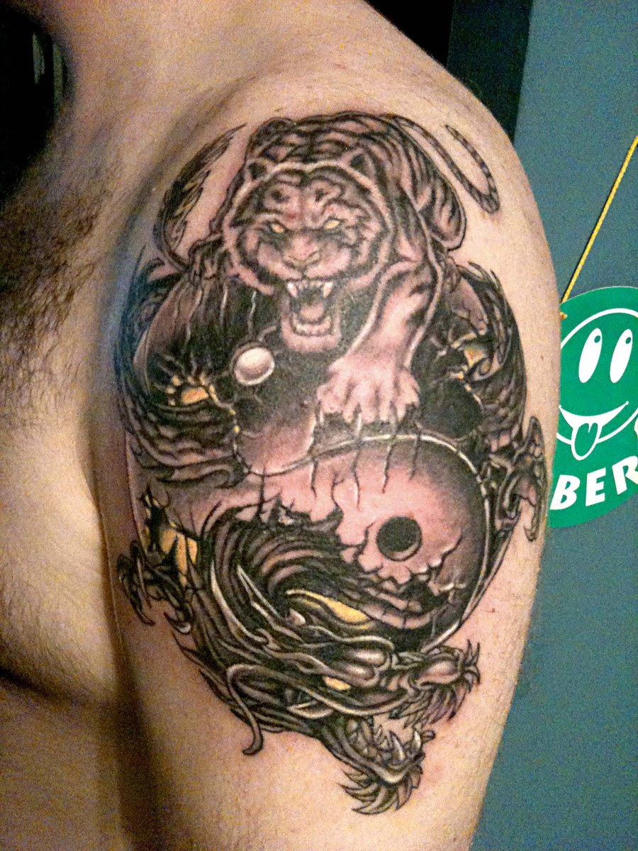 Tiger And Dragon Yin Yang Tattoo On Left Shoulder