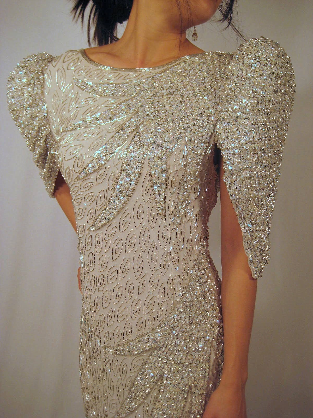 Spectacular Dazzling Grand Entrance.  smashing pearly angel jewel beaded cream and silver ball gown
