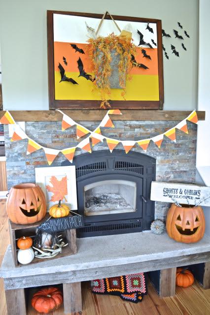 Halloween-Mantel-NewlyWoodwards4-candy-corn DIY halloween decorations