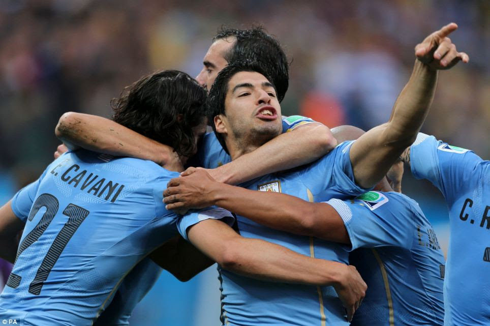 Uruguay's Luis Suarez (centre) celebrates scoring their first goal of the game during the Group D match