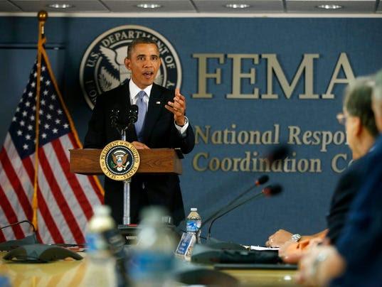 http://www.gannett-cdn.com/-mm-/14ab4692ccb3ec6f7645dd338832a14630eaaf1a/c=99-0-4520-3326&r=x404&c=534x401/local/-/media/USATODAY/test/2013/10/07/1381166222000-AP-Obama-FEMA-001.jpg