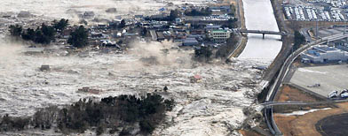 Earthquake-triggered tsumanis sweep shores along Iwanuma in northern Japan (AP/Kyodo News)