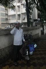 Even Heavy Rains Cant Stop The Flight of The Dabbawala. by firoze shakir photographerno1