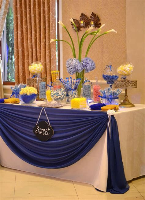 Blue and yellow candy table   Chez Rose floral designs in