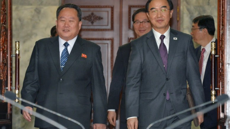 South Korea's Unification Minister Cho Myoung-gyon (R) and Ri Son-gwon (L), chief of North Korean agency in charge of affairs with the South, walk into a meeting room for high-level talks at the truce village of Panmunjom, 29 March 2018. The two sides agreed to hold an inter-Korean summit on 27 April. EPA, YONHAP SOUTH KOREA OUT