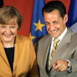 French Interior Minister and UMP party President Sarkozy poses with German CDU President Merkel in Paris