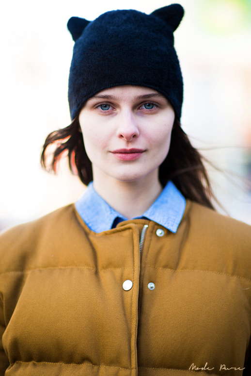 LE FASHION BLOG CAT EAR HATS STREET STYLE FASHION WEEK FASHION MONTH MODEL NATURAL BEAUTY  MUSTARD YELLOW BROWN COLLARLESS PUFFER JACKET DENIM CHAMBRAY COLLARED BUTTON UP Vasilisa Pavlova MODA PURE
