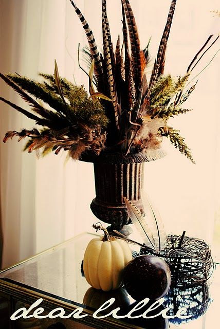I really like this feather based centerpiece. We could still incorporate plants with it too.
