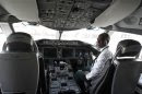 Kebede, an Ethiopian Airlines manager, sits inside the cockpit of their 787 Dreamliner after it arrived at the Jomo Kenyatta international airport in Kenya's capital Nairobi