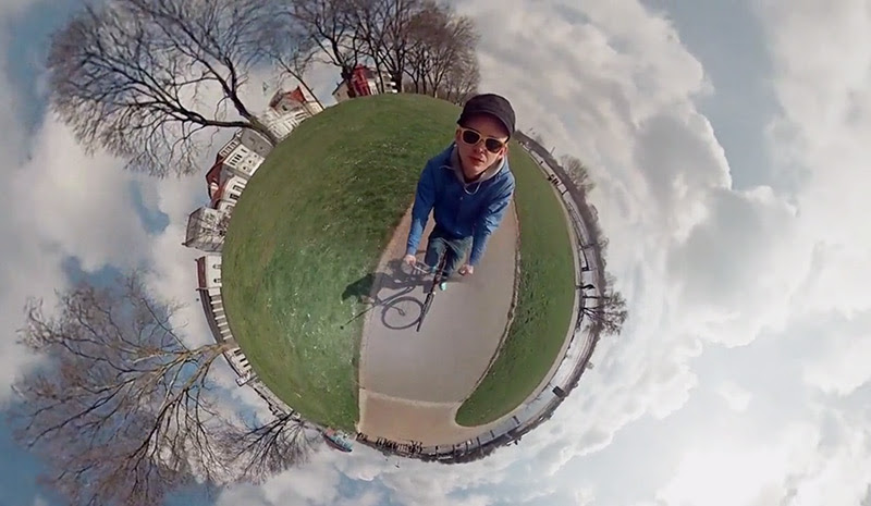 360° Panoramic Video Creates the Illusion of a Man Riding a Bike around a Tiny World video art