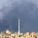 Smoke from a bomb that killed three top officials clouds Syria's capital on July 18.