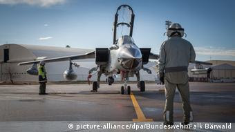 A German military pilot and plane at Incirlik airforce base in Turkey