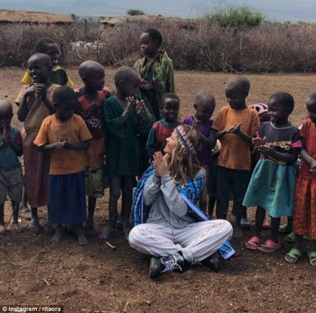 Serenaded: The British star visited a Masai village, sharing a sweet video of herself with a the local children