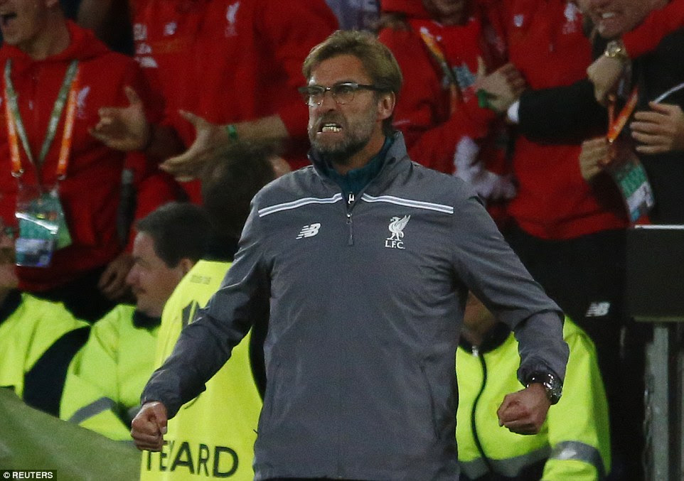 Liverpool manager Klopp celebrates the opening goal with his typical touchline histrionics