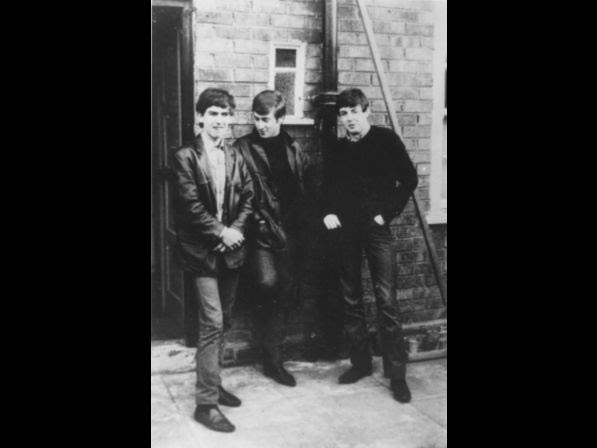 Liverpudlian skiffle beat band The Beatles standing outside Paul's Liverpool home in 1960 (left to right) George Harrison (1943 ­ 2001), John Lennon (1940 ­ 1980), Paul McCartney. Ringo Starr was not to join the band for another two years.