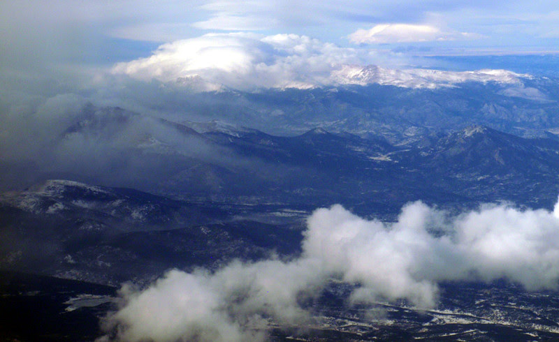 14,255-foot Longs Peak, Colorado's 15th tallest, enshrouded in clouds and creating its own weather (top center).