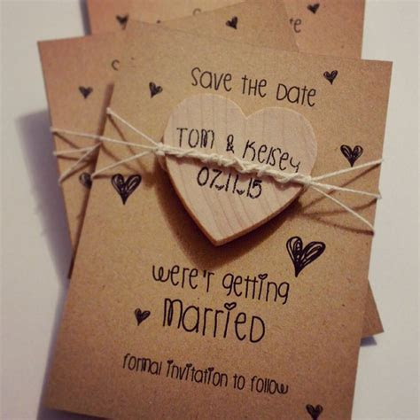 Home made save the dates, rustic wood heart magnets