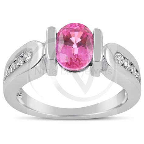 Oval Cut Tension Set Pink Sapphire & Channel Set Diamonds