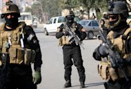 Iraqi anti-terror police stand guard at a checkpoint in Baghdad, on January 6, 2011