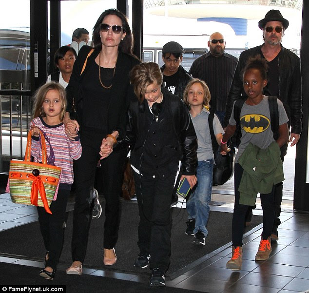 Family man: Brad gushed that one of the benefits ofworking on the movie together was that they could spend more time with their children, Maddox, 14, Pax, 11, Zahara, 10, Shiloh, nine, and seven-year-old twins Knox and Vivienne