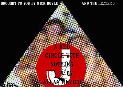 a red circle with nothing (the letter J) in it by allan revich and mick boyle