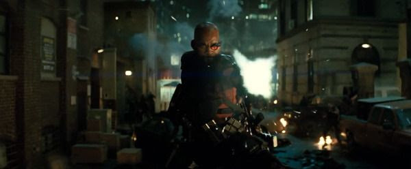 Deadshot (Will Smith) unleashes firepower on fellow bad guys in SUICIDE SQUAD.