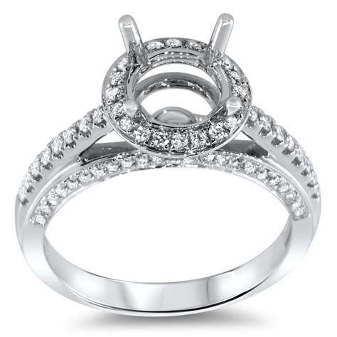 Round Halo Engagement Ring with Stones on 3 Side Stones