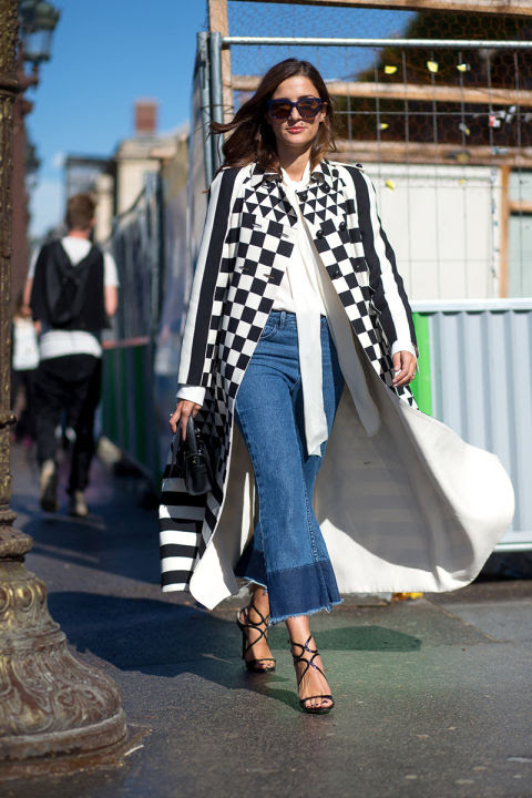 flare jeans frayed cropped flares strappy sandals checkered coat black and white tie neck blouse bow neck blouse statement coat fall coat mod hbz-street-style-paris-fashion week pfw-fall fashion eleanora carisi