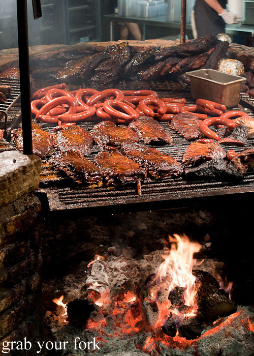 ribs sausages and brisket on the open barbecue at the salt lick bbq driftwood austin texas