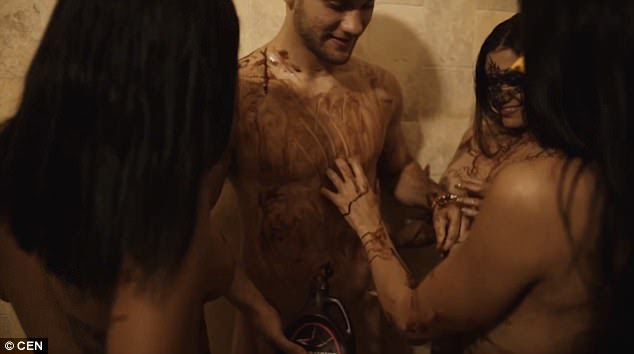 Messy: The action then cranks-up a notch when his fellow party-goers get hands-on