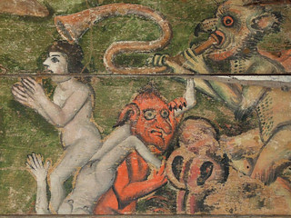 Wenhaston Doom: naked man and woman dragged down to hell by demons