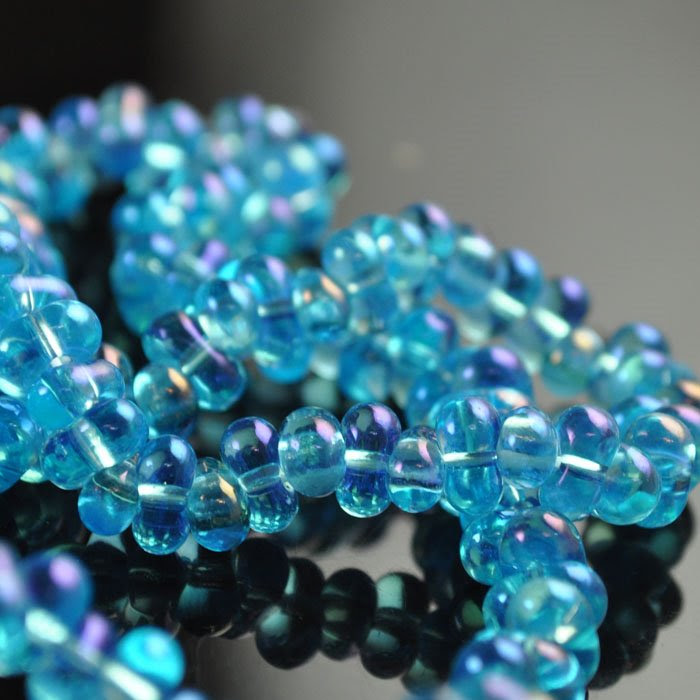68002528 Czech Seedbeads - 4 x 6 mm Farfalle - Transparent Aqua Rainbow (1 strand)
