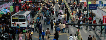 Pedestrians and motor vehicles on a busy urban street