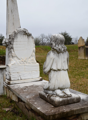 Kneeling child statue