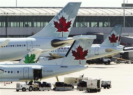 Air Canada aircraft are seen at Toronto Pearson International Airport, in this September 20, 2011 file photo. REUTERS/Mark Blinch/Files