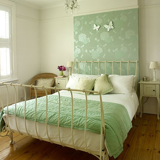 Master bedroom with pretty green feature wall | Master