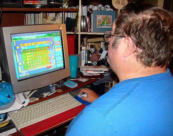 James at his computer