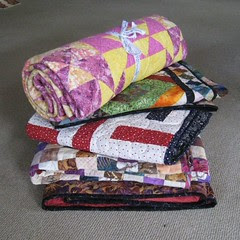 finished pile of quilts