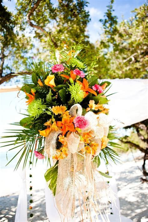 Tropical beach wedding ceremony with orange and pink