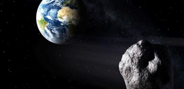 Concepção artística de asteroide passando de raspão pela Terra