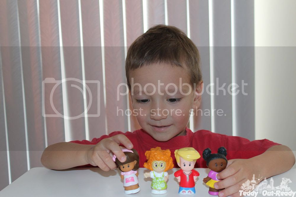 Teddy playing with Little People