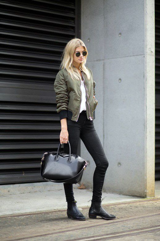 Le Fashion Blog Model Street Style Megan Irwin Round Sunglasses Green Bomber Jacket Givenchy Antigona Bag Skinny Jeans Leather Boots Via Harpers Bazaar 1