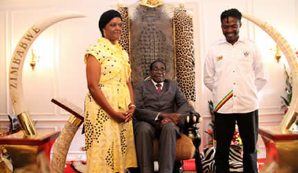 Republic of Zimbabwe President Robert Mugabe and First Lady Amai Grace standing and sitting along with artist who developed the project. by Pan-African News Wire File Photos