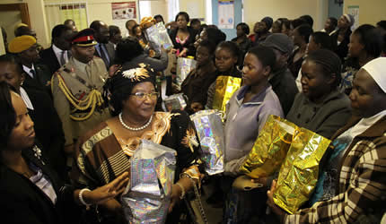 Malawi President Joyce Banda at the Kuwadzana Clinic in the Republic of Zimbabwe. She handed out gifts to the people. Banda is in Zimbabwe for the International Trade Fair in Bulawayo. by Pan-African News Wire File Photos