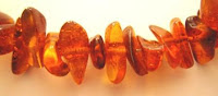 Close up of stringed amber necklace