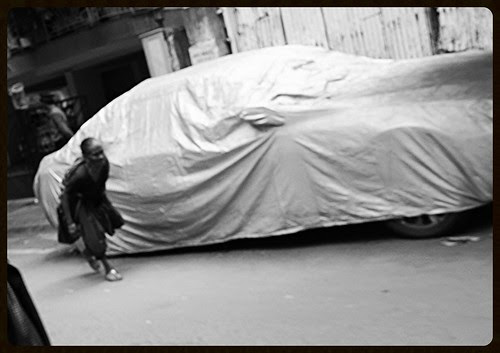 The Poor Womans Sorrow And The Rich Mans Car by firoze shakir photographerno1
