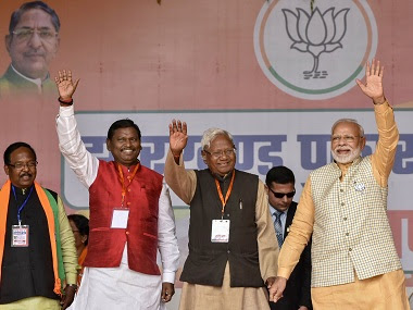 Prime Minister Narendra Modi along with Union Minister for Tribal Affairs Arjun Munda waves to the crowd during an election campaign rally, ahead of 2nd phase of State Assembly elections, at Khunti district of Jharkhand, Tuesday, Dec. 3, 2019. (PTI Photo)(PTI12_3_2019_000080B)