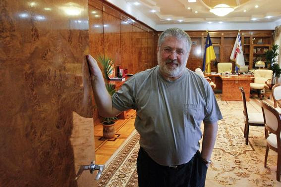 Igor Kolomoisky, billionaire and governor of the Dnipropetrovsk region, poses for a picture at his cabinet in the regional government headquarters in Dnipropetrovsk in this May 24, 2014 file photo.     REUTERS-Valentyn Ogirenko-Files